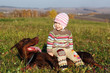 Girl sitting on the Doberman